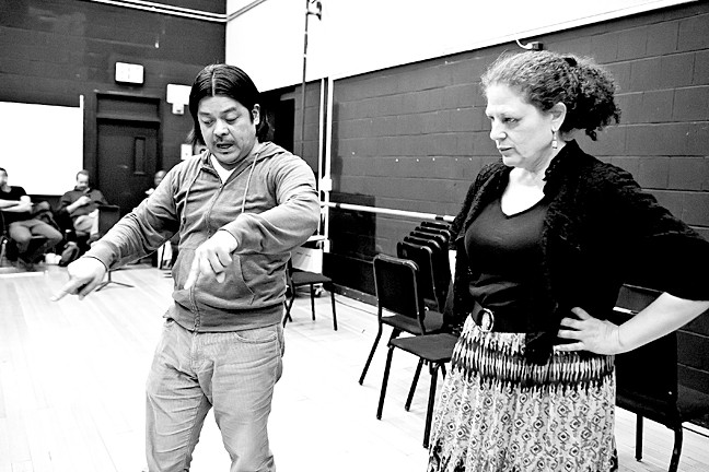 Director Rod Gomez gives direction to Leslie Swanson who plays Flora in the rehearsal of Giuseppe Verdi's 'La traviata' at Lehman College.