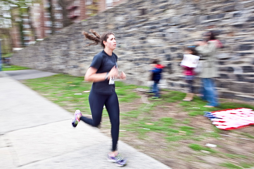 Lauren Southwick, 24, speeds around the corner of Riverdale Avenue and West 256th Street on her way to complete the half marathon. She finished at 01:44:10.