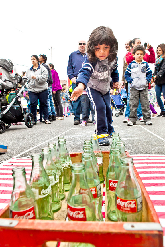 Andrew Corniel, 4, plays a game of bottle toss at the South Riverdale Avenue Festival on Sunday. Hundreds turned out to enjoy rock climbing and games,face painting, music and shopping.