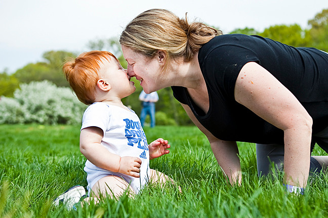 Jacob Chirch, 1and his mother Susan Chirch, 35, touch noses at the New York Botanical Gardens' Daffodil Hill during a Mother's Day Weekend Garden Party on Saturday.