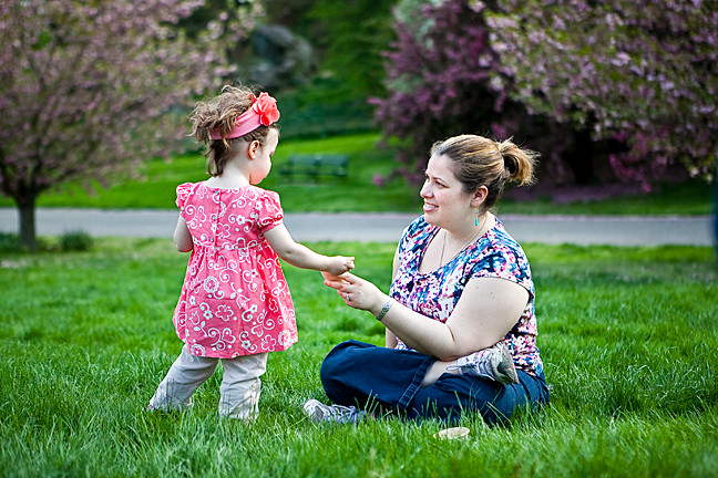 Jean Mary Bongiorno, 38, feeds ice cream to her daughter Grace Horne, 2, on Daffodil Hill at The New York Botanical Gardens as part of the Mother's Day Weekend Garden Party on Saturday.