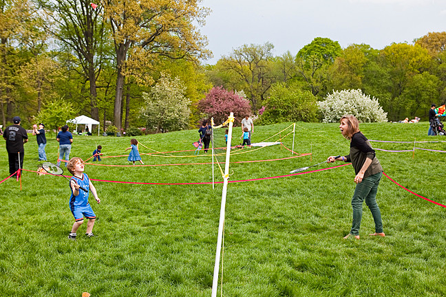 Norma Irom and her grandson Raphael Irom, 6, play a hand of Badminton on Daffodil Hill at The New York Botanical Gardens as part of the Mother's Day Weekend Garden Party on Saturday.