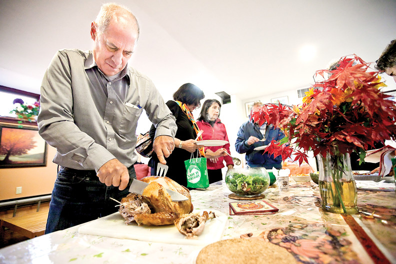 John Benfatti, who organizes an overnight shelter for homeless men at the Riverdale-Yonkers Society for Ethical Culture, carves a turkey for a pre-Thanksgiving gathering at the site last year.