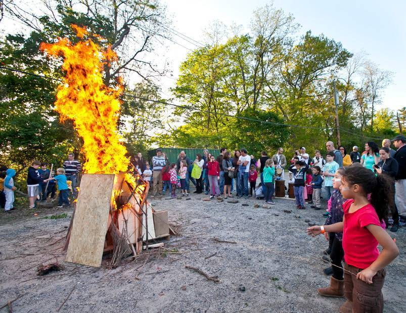 A bonfire at The Riverdale Y mesmerizes onlookers on Sunday. The blaze was part of a celebration of Lag B'Omer, a holiday gaining popularity in Riverdale.