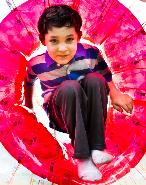Donny Rosenrauch, 5, exits a giant, inflatable hamster ball at the Chabad's event.