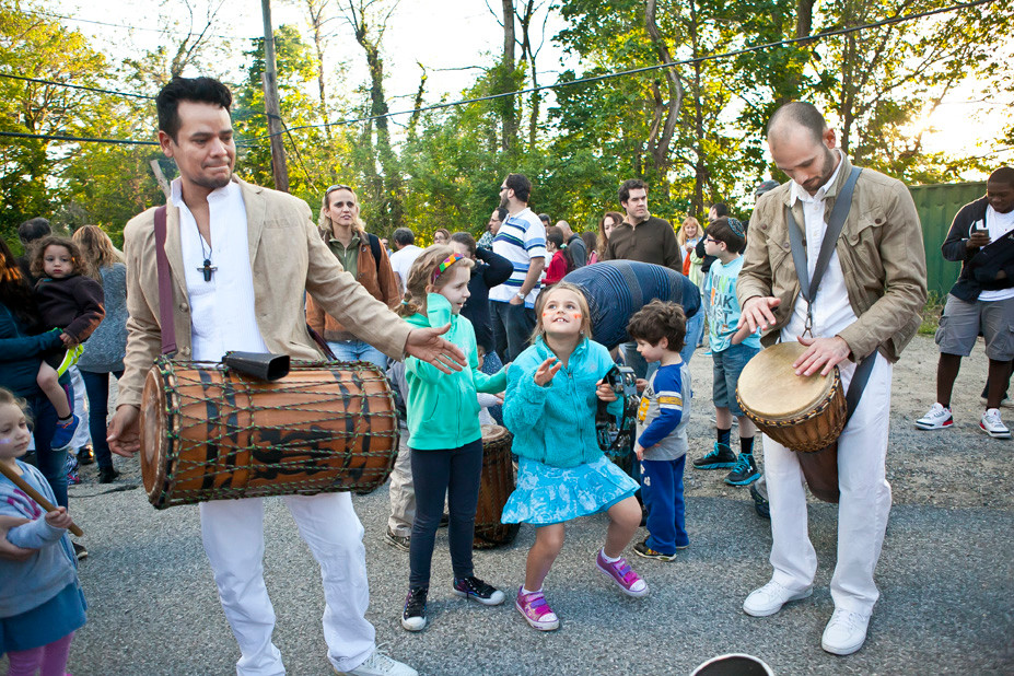 Natalie Allon, 8, beats to the rhythm along with Justine Toca and Roberto Carlo of Toca NYC.