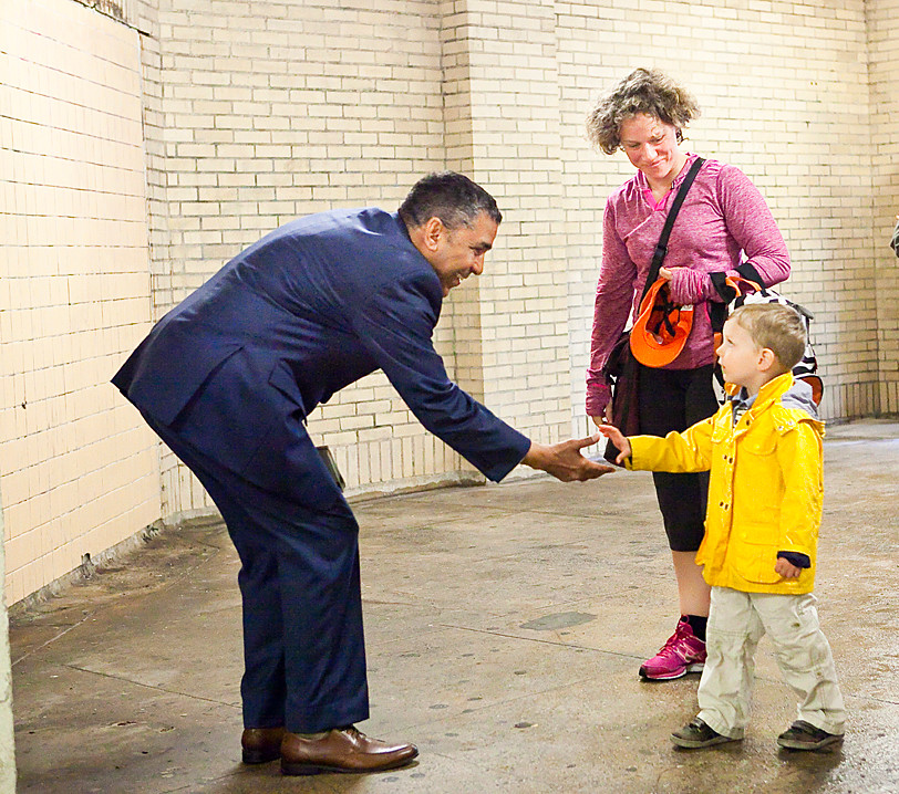 Mr. Espaillat shakes hands with Sam Sesquin, 4, at the A train station on 181st street in Upper Manhattan on May 15. Sam's mother Amanda MacBlane, 35, later explained who Espaillat is to the boy.