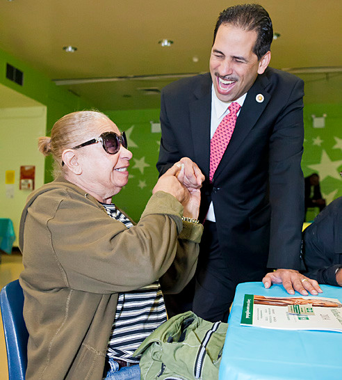 Olive Svitzer, 80, meets Councilman Fernando Cabrera at a Mother's day celebration at the Ft. independence Houses' community center on May 9.