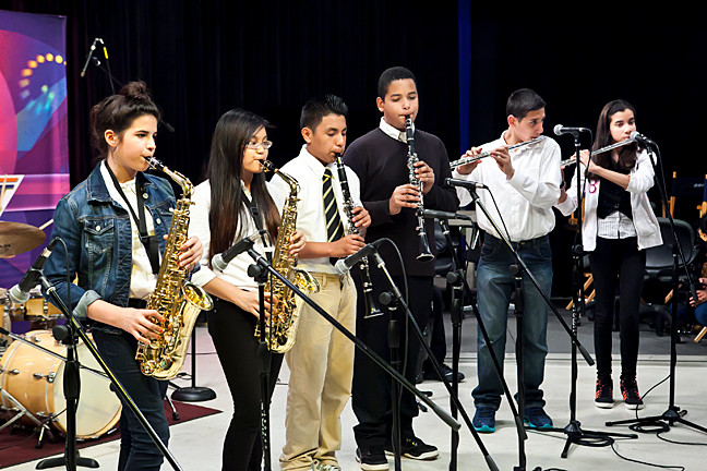 Alexa Jablonski, 13, and Pamela Verzonilla, 14, on sax, Christian Lucas, 13 and Steven Roasario, 13 on clarinet, Nicolas Ramirez, 13 and Lillyann Mena, 14 on flute, at the sound check of the recording session of the The New School for Leadership and the Arts band at the Bronx Net Studios on the Campus of Lehman College on May 22.
