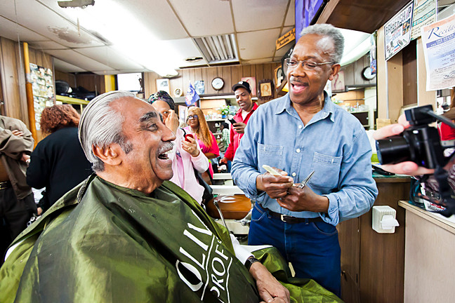 "Rep. Charles Rangel reminisces with Roosevelt ""Rosey"" Spivey while receviing a hair- cut at the storied Marble Hill barbershop on Saturday."