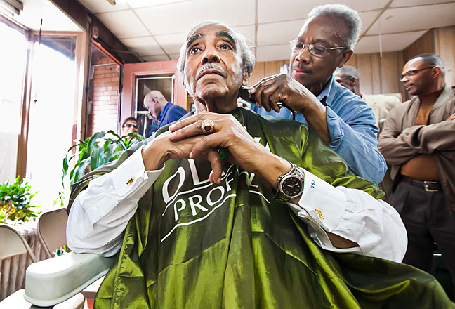 Rep. Charles Rangel gets a hair cut by Roosevelt 'Rosie' Spivey, 75, owner of Marble Hill Barbershop on Saturday.