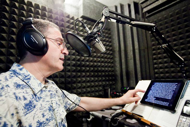 Robert Fass, 55, on Monday, June 2, in his home audio recording studio where he does a practice run for his next audiobook.