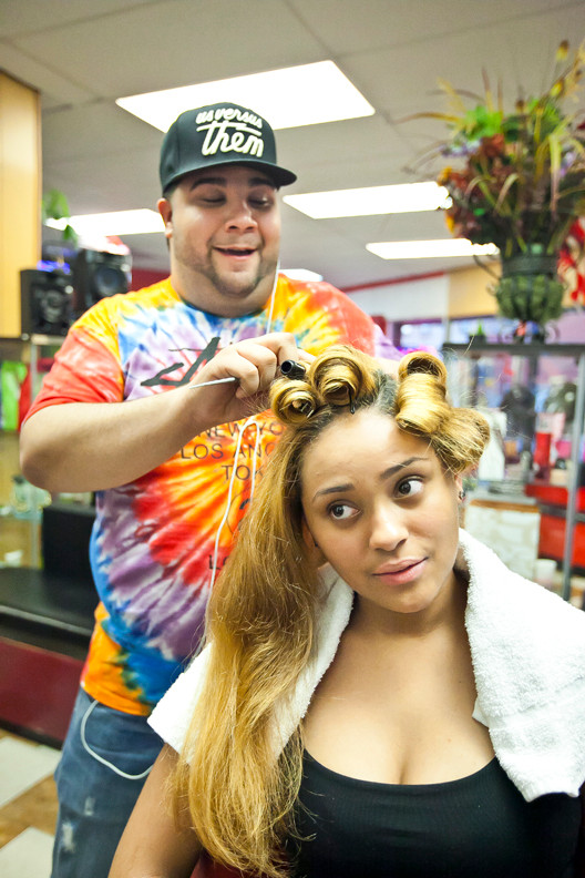Joshua Laureano, 25, blows out Destiny Burgos' hair the afternoon before John F. Kennedy High School's prom on May 30.