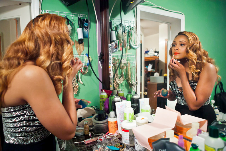 Destiny Burgos, 17, puts the finishing touches on her makeup as she gets ready for the final prom for the senior class at John F. Kennedy High School on May 30.