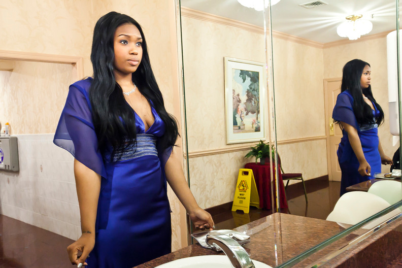 Jasmine Delts, 19, looks in the bathroom mirror at Maestros Caterers  before heading back to the ballroom where John F. Kennedy had their final prom on May 30.