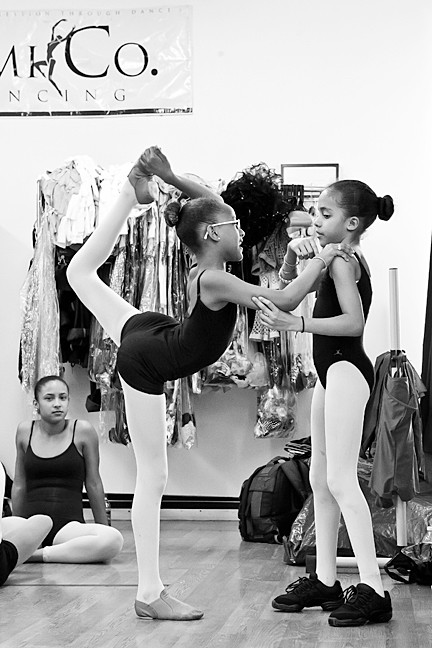 Byanna Rodriguez helps Sadge Millian, both 9, make a scorpion pose.
