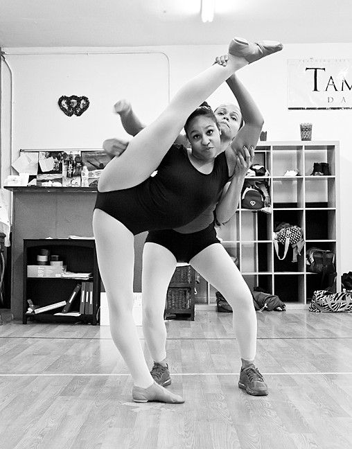 Tamiko Maldonado the owner of TamiCo. Dancing, helps Melany Blanco, 13, with her moves.