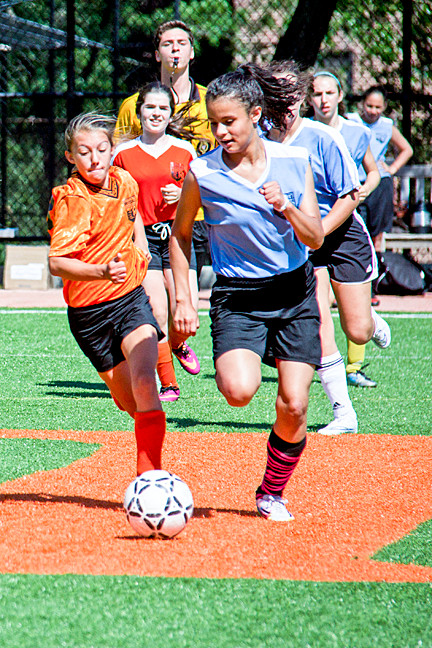 Isabella Tusha, 12, of team Agent Orange, and Jisselle Mayi, 13, of the Blueberries, during girls� soccer playoffs. This match ended in a 0-0 tie.