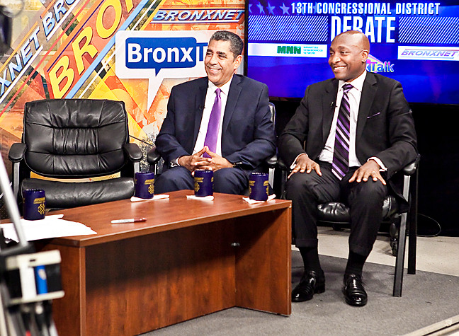 State Sen. Adriano Espaillat and Rev. Michael Walrond next to an empty seat representing Rep. Charles Rangel at a debate aired on Monday, June 16.