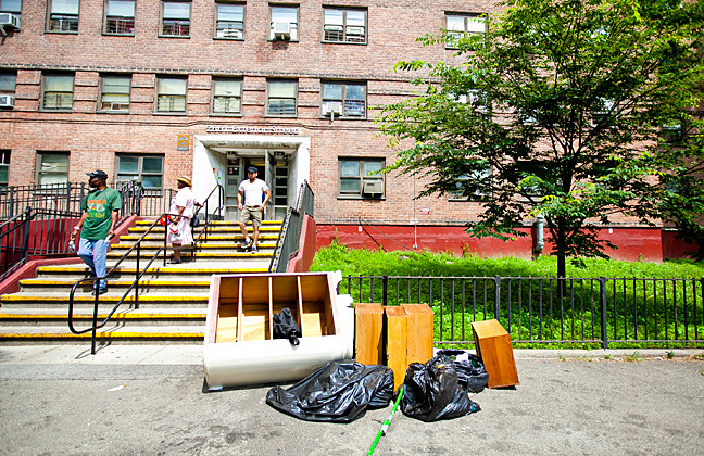 Trash, clothing, large furniture are left on areas in non dumping site in the front of 2861 Exterior Street in a NYCHA building in Marble Hill on June 23.