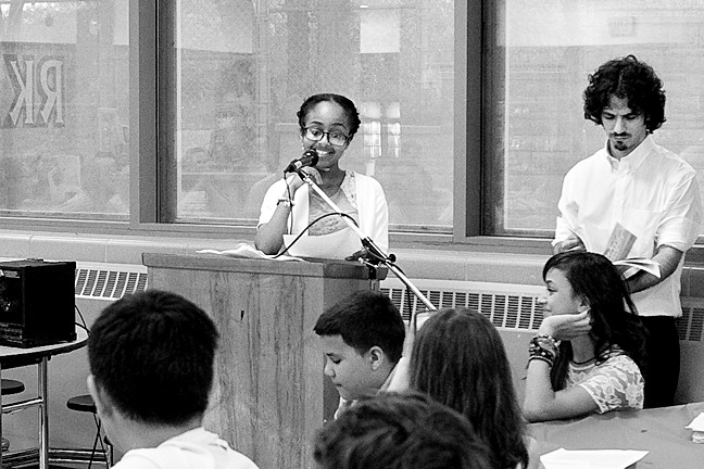 Rachel Abebe reads her interpretation of 'The Hunger Games' at the David A. Stein Riverdale/Kingsbridge Academy (M.S./H.S. 141) on June 18.