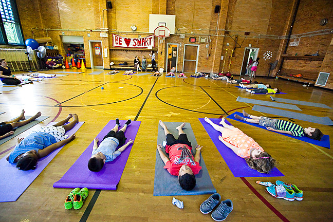 Students from P.S. 81 take part in yoga in the gym, made possible by a grant from the Department of Education (DOE) to start a School Wellness Council.