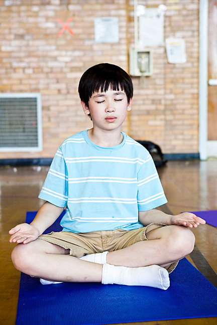 Sam Evans, third grader from P.S. 81 take part in yoga in the gym, made possible by a grant from the Department of Education (DOE) to start a School Wellness Council.