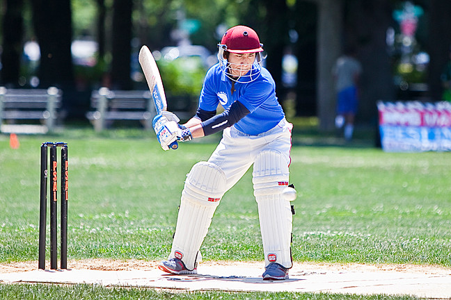 Muyin Arifuk, a DeWitt Clinton High School student on the Brooklyn, Bronx and Manhattan All-Stars squad, takes a swing during the 2014 NYC Mayor's Cup Cricket game on Saturday.