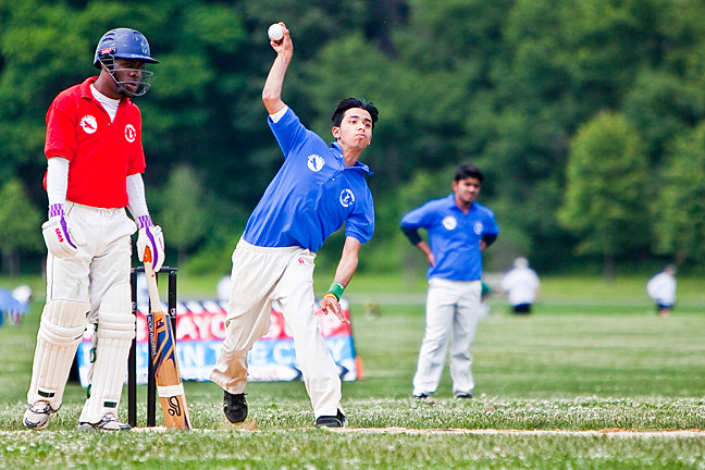 Asmar Khan, a Dewitt Clinton High School student takes his turn as the bowler in the 2014 NYC Mayor's Cup Cricket All-Star Game for the Brooklyn, Bronx and Manhattan All-Stars team on June 21.