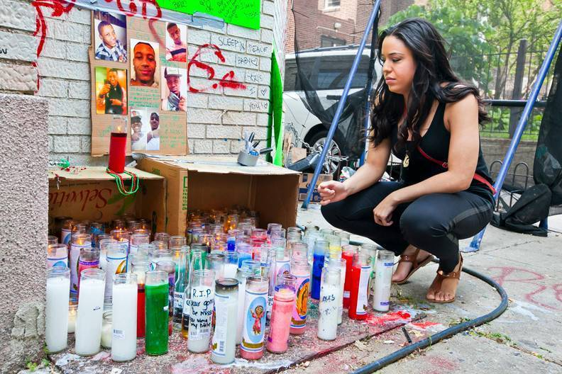 Yanira Rosario, 30, at a memorial for murder victim Roderick Romney on Reservoir Avenue. Ms. Rosario said she had known Mr. Romney for over 16 years.