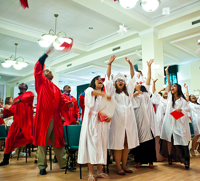 John F. Kennedy High School graduates celebrate at the Smith Auditorium at Manhattan College on June 26.