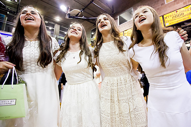 Sarah Gabay, Rachel Cohen, Malka Kaminetzky and Kate Weinberg sing and celebrate at the reception for the Salanter Akiba Riverdale Academy's graduation ceremony on June 18.