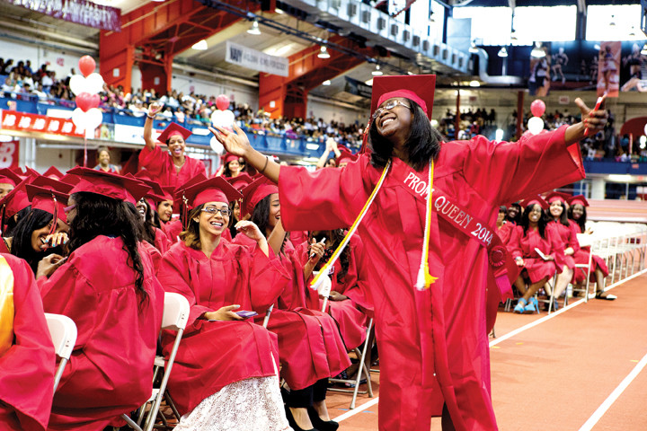 Magic Washington dances at the graduation ceremony for DeWitt Clinton High School's class of 2014. The proceedings took place at the Armory Track in Manhattan on June 26.