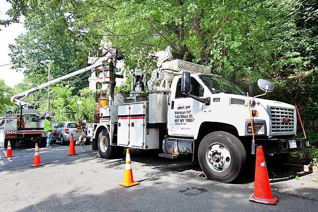 Verizon Construction technicians install fiber optic cables and related equipment on Johnson Avenue and West 230th street as part of their citywide infrastructure work.