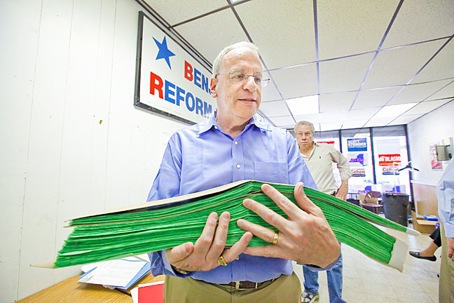 Assemblyman Jefrey Dinowitz holds thousands of petitions at the Benjamin Franklin Reform Democratic Club on Monday.