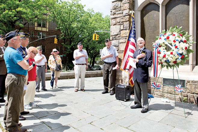 Veterans of American Legion Post 1525 led a small crowd in singing 'God Bless America' on Monday, May 26, 2014, Memorial Day, at the Memorial Bell Tower at West 239th Street and Riverdale Avenue.