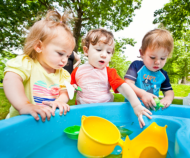Julie Remin, 16-months-old, Sebastian Welsh, 15-months-old and Judah Linder, 18-months-old play at the water table.