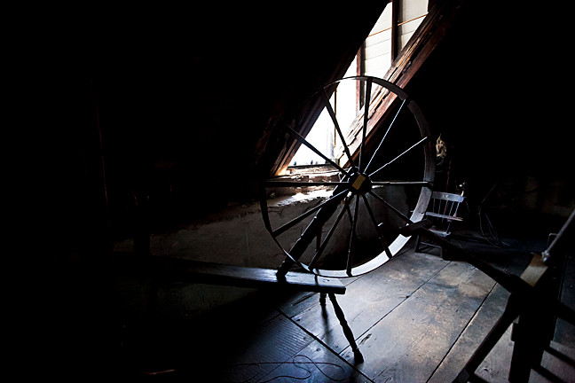 An old spinning wheel sits in the attic of the Van Cortlandt House Museum.