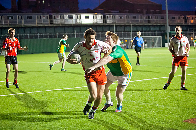 Joe Bell, in white, for Tyrone, keeps the ball away from Luke Barret, for St. Barnabas, at Gaelic Park. Find out how the Gaelic Football season is going,