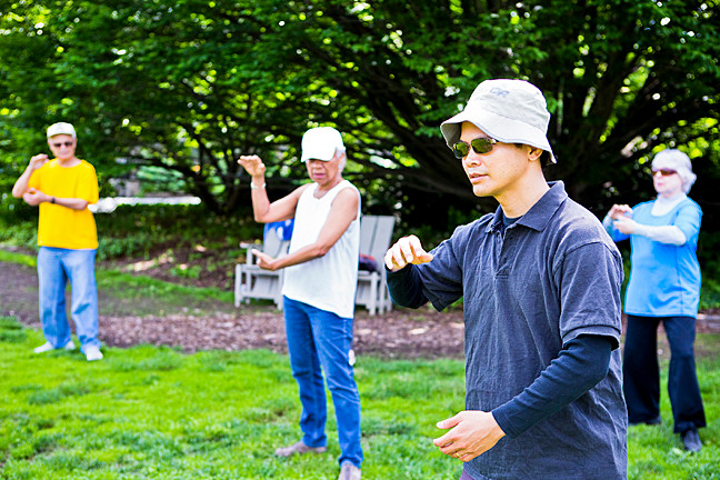 What better place for practicing t'ai chi than on the lawn at Wave Hill? Irving Yee, in the foreground, teaches the practice to a small but enthusiastic group of followers including Pilar Enright, left, and Suzanne Manning, right, on a recent Saturday.