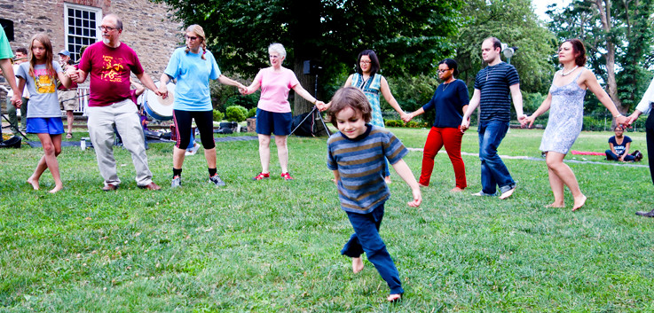 Donovan Kirmser, 4, spins in the middle of a circle dance.