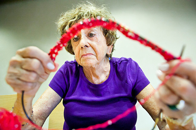 Frieda Cohen, 79, who has been knitting since she was 9, crafts a shrug at the Kingsbridge Library's knitting and crocheting group, held very Monday from 3 to 5pm.