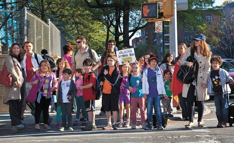 Students and parents flood the corner of 236th Street and Independent Ave on Walk to School Day in April 2012.
