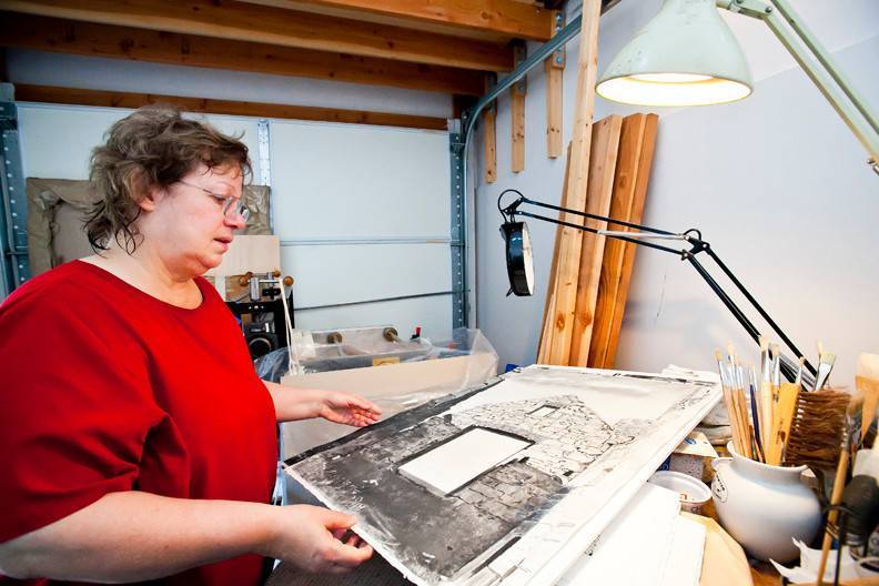 Agnes Murray looks at one of her award-winning monotypes depicting a famous Scottish castle insider her West 259th Street home studio.