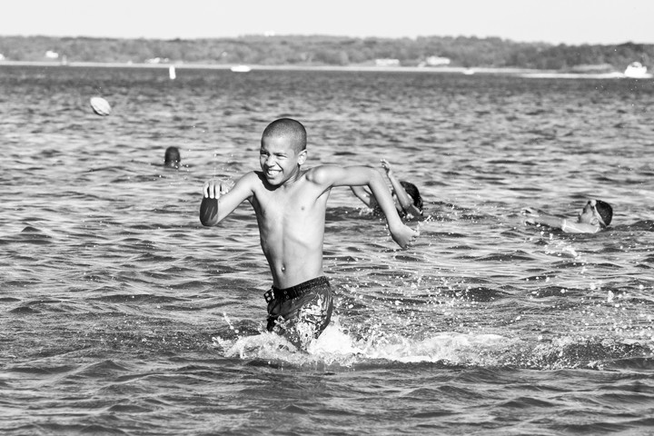 William Atwood, 9, runs out of the waters of Orchard Beach.