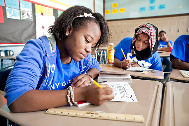 Jameilla Davis and Hamdallah Awal, both 14, in geometry class at the Sports and Arts in Schools program at DeWitt Clinton High School on July 31.