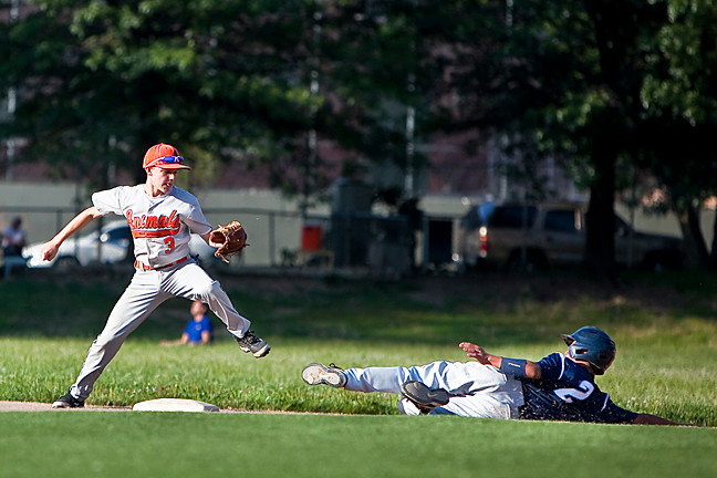 Connor 'C3PO' McKeown of the South Riverdale Animals tries to put a tag on Daniel Helfgott on the Bayside Yankees at Seton Park on Monday.
