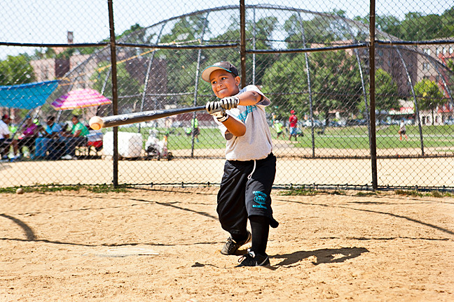 Justine Espinoa, 6, takes batting practice at the Van Cortlandt League morning baseball camp sessions on Wednesday, July 30, 2014.