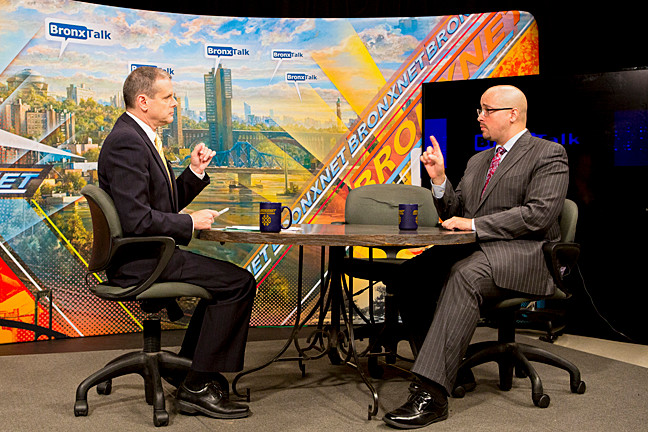 Sen. Gustavo Rivera, right, on �BronxTalk� with Gary Axelbank on Monday. An empty chair represents Mr.Rivera�s challenger, Councilman Fernando Cabrera, who declined to participate in the debate.