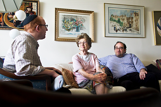 Rabbi Joshua Yuter, 37, chats with his grandmother, Eva Bender, 85, and his uncle Barry Bender, 48, the day before he is set to depart to Israel.